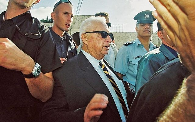 Former prime minister Ariel Sharon leaves the Temple Mount on September 28, 2000. (photo credit: Flash90)