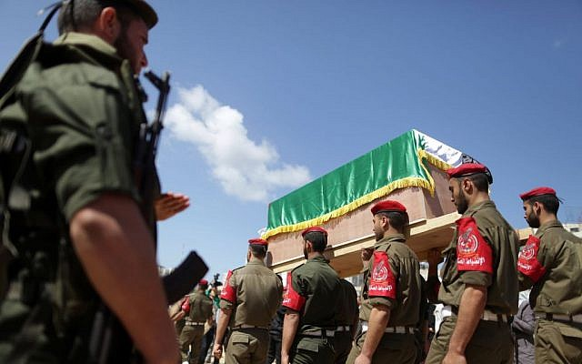 Palestinian Hamas militants hold a symbolic coffin of Maisara Abu Hamdiyeh, an Israeli-held prisoner who died of cancer while in detention, during a protest against his death in Gaza City on April 04, 2013 (photo credit: Wissam Nassar/FLASH90)