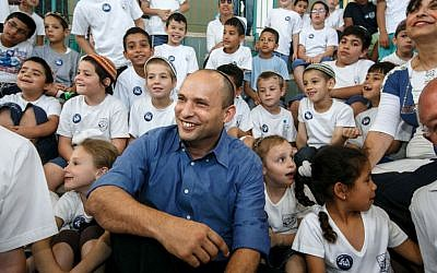 Jewish Home party leader Naftali Bennett with children during a visit to the West Bank settlement city of Ariel, on June 4, 2013. (Assaf Shilo/Israel Sun/Flash 90)