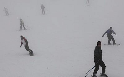 Israelis seen skiing on the snowcovered slopes of Mt Hermon, in Northern Israel (Photo credit: Yaakov Naumi/Flash90)