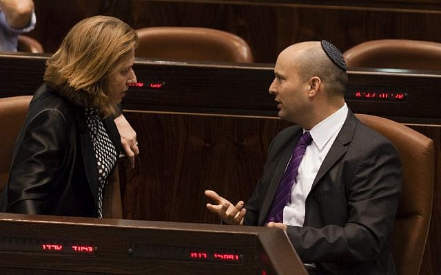 Justice Minister Tzipi Livni, left, speaks with Economy Minister Naftali Bennett at a Knesset session marking 18 years since the assassination of prime minister Yitzhak Rabin, October 16, 2013 (photo credit: Flash90)