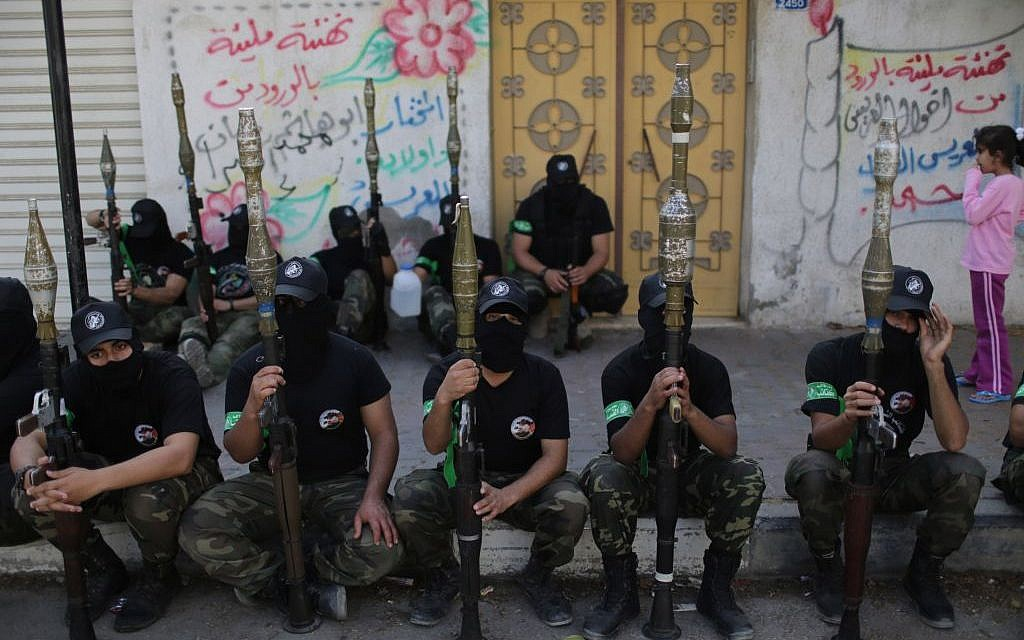 Hamas fighters sitting during an anti-Israel parade in Gaza in November, 2013. (photo credit:  Wissam Nassar/Flash90)