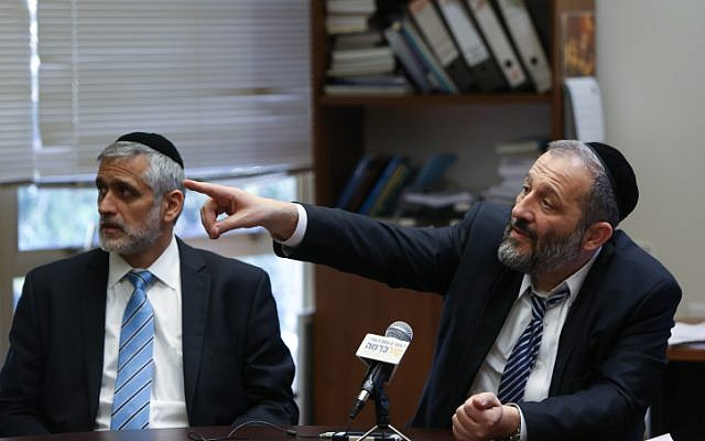 Shas party leader Aryeh Deri (right) and his predecessor Eli Yishai (photo credit: Yonatan Sindel/Flash90)