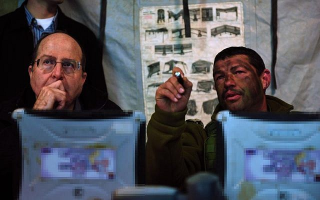 Moshe Ya'alon, left, meeting with troops in December 2013. (photo credit: Ariel Hermoni/Ministry of Defence/FLASH90)