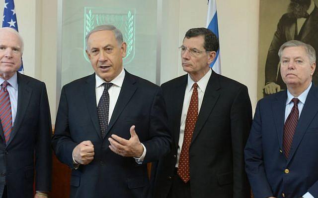 From left: Sen. John Mccain, Prime Minister Benjamin Netanyahu, Sen. John Barrasso and Sen. Lindsey Graham in Jerusalem in January, 2014 (photo credit: Amos Ben Gershom/GPO/Flash90)
