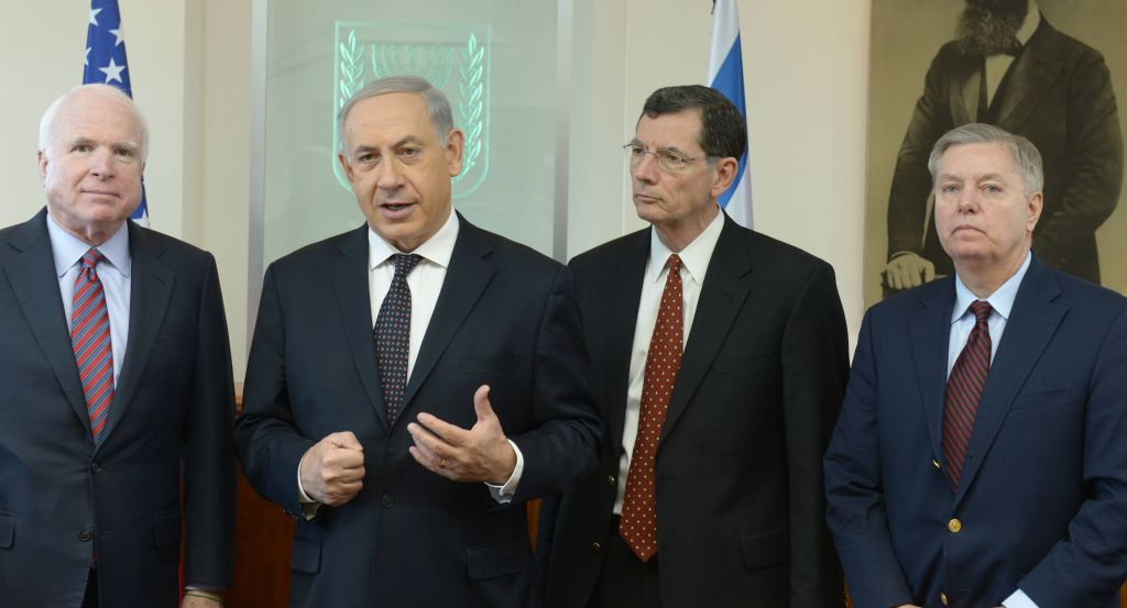 From left: Sen. John Mccain, Prime Minister Benjamin Netanyahu, Sen. John Barrasso and Sen. Lindsey Graham in Jerusalem on Friday (photo credit: Amos Ben Gershom/GPO/Flash90)