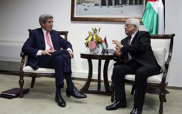 US Secretary of State John Kerry (L) meets with President  of the Palestinian Authority Mahmoud Abbas in the West Bank city of Ramallah on January 3, 2014. (photo credit: Issam Rimawi/Flash90)