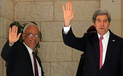 US Secretary of State John Kerry (R) and Palestinian chief negotiator Saeb Erekat wave before a meeting with Palestinian Authority President Mahmoud Abbas at the presidential compound in the West Bank city of Ramallah January 4, 2014. (Issam Rimawi/Flash90)
