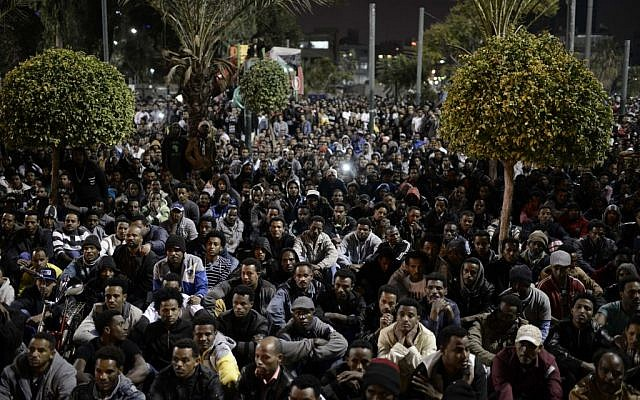 Thousands of African asylum seekers participate in a meeting at the Levinsky Park, Tel Aviv, Israel, Saturday night, January 4, 2014. (photo credit: Tomer Neuberg/Flash90)