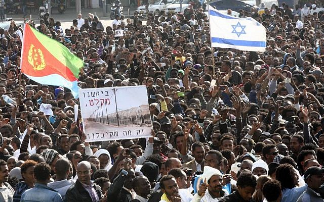 Thousands of asylum seekers from Eritrea and Sudan protest the Israeli government's neglect in reviewing asylum requests and the state's detention policies, at a demonstration held at Rabin Square, central Tel Aviv, January 05, 2013. (photo credit: Roni Schutzer/Flash90)