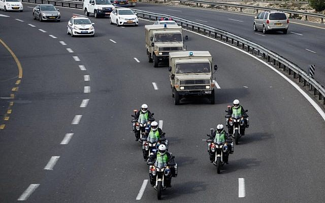 A police convoy escorts the casket of former prime minister Ariel Sharon along Route 1 to Jerusalem, Sunday, January 12, 2014 (photo credit: Flash90)