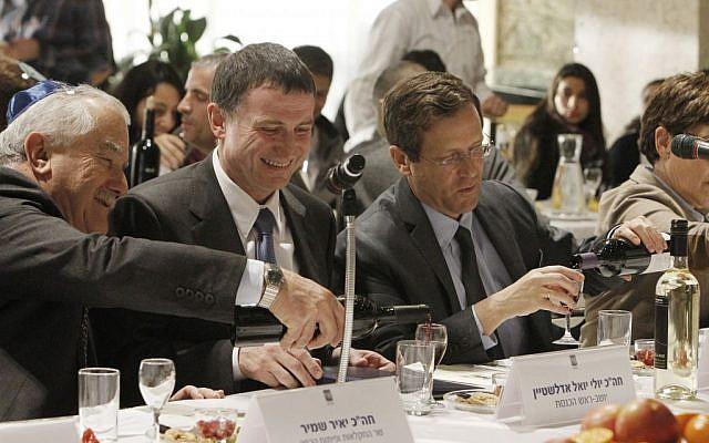 Knesset speaker Yuli Edelstein, Agriculture Minister Yair Shamir, and Labor Party head Isaac Herzog celebrating the Knesset's first ever Tu Bishvat seder (photo credit: Miriam Alster/Flash90)