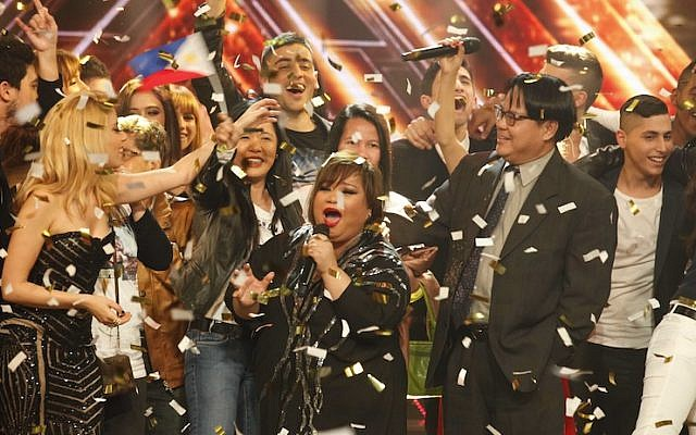The finale of Israel's X-Factor TV show, after Rose Fostanes was declared winner of the singing contest on January 14, 2014. Fostanes, a Filipina migrant working and living in Israel, beat four Israelis finalists. (Photo credit: Tal Givony/HANDOUT PICTURE/Flash90)