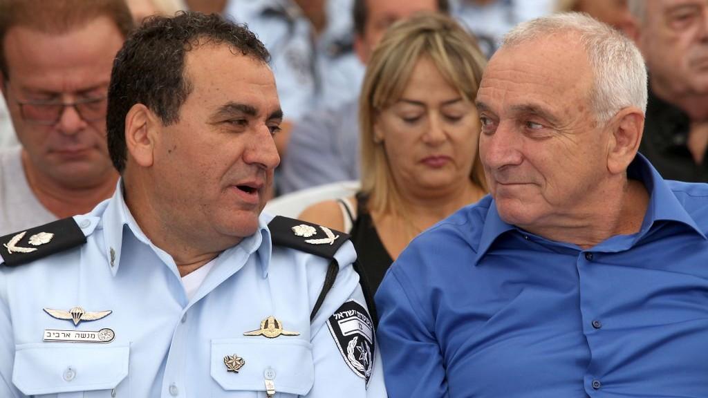 Menashe Arviv (left) is alongside Public Security Minister Yitzhak Aharonovitch, September 16, 2013 (photo credit: Gideon Markowicz/Flash 90)