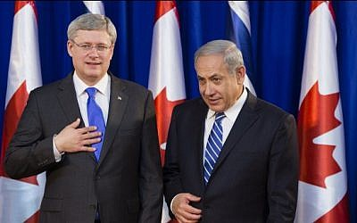 Prime Minister Benjamin Netanyahu (R) seen with his Canadian counterpart Stephen Harper during a welcoming ceremony for Harper at Netanyahu's office in Jerusalem January 19, 2014.  (photo credit: Flash90)
