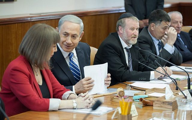 Prime Minister Binyamin Netanyahu speaks with Culture and Sports Minister Limor Livnat (L) during the weekly cabinet meeting at the Prime Minister's Office in Jerusalem on January 19, 2014. (photo credit: Emil Salman/POOL/Flash90)
