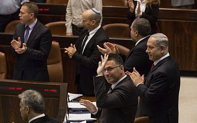 Knesset members give a standing ovation after the speech by Canadian Prime Minister Stephen Harper, on Monday, January 20, 2014. (Photo credit: Flash 90)