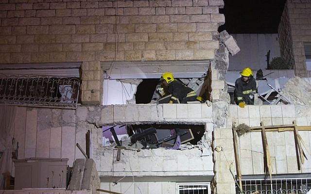 Rescue and medical personnel at the scene of a gas explosion that killed three people in Jerusalem's Gilo neighborhood, early Monday morning, January 20, 2014 (photo credit: Yonatan Sindel/Flash90)