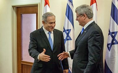 Canadian Prime Minister Stephen Harper (right), meets with Prime Minister Benjamin Netanyahu at Netanyahu's office in Jerusalem, during Harper's official state visit to Israel and the West Bank, Tuesday, January 21, 2103 (photo credit: Emil Salman/Pool/Flash 90)
