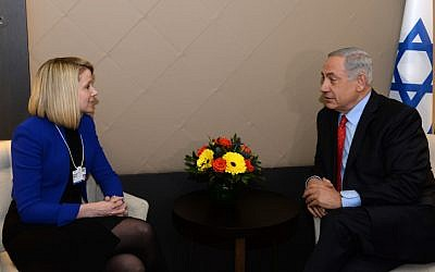 Israel Prime Minister Benjamin Netanyahu (R) meets with President and CEO of Yahoo, Marissa Mayer during the annual meeting of the World Economic Forum (WEF) in Davos, Switzerland on January 22, 2014. (Photo by Kobi Gideon/GPO/Flash90)