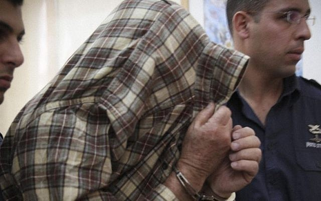 The exterminator who left the poison that led to the deaths of two children in Givat Mordechai is seen during a court hearing in Jerusalem on January 23, 2014. Photo by Hadas Parush/Flash90