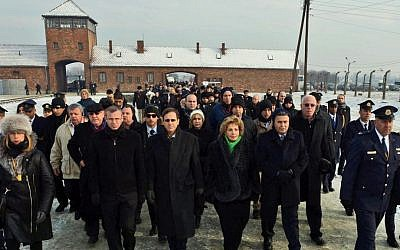 Knesset members and other Israeli dignitaries walk through the entrance to the Auschwitz concentration camp in Poland on International Holocaust Remembrance Day, January 27, 2014. (Photo credit: Haim Zach/GPO/Flash90)