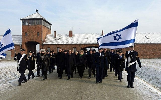 Israeli Knesset members walk through the main gate of the Auschwitz concentration camp, in Poland, January 28, 2014 (photo credit: Haim Zach/GPO/Flash90)