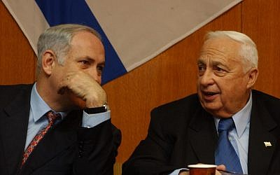 Benjamin Netanyahu speaks with Ariel Sharon in 2003. (photo credit: Flash 90)