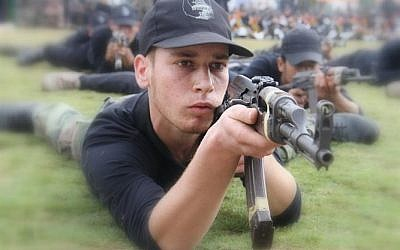 A child practices shooting at the 'pioneers of liberation' camp in Gaza (photo credit: Hamas interior ministry website)