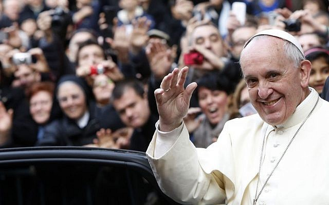 Pope Francis waves as he leaves Rome's Jesus' Church to celebrate a mass with the Jesuits, on the occasion of the order's titular feast on Friday, January 3, 2014. (photo credit: AP/Riccardo De Luca)