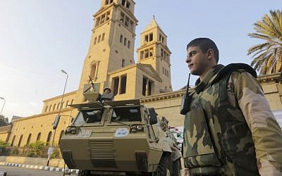 An armored military vehicles secures Cairo's St. Mark's Cathedral on Monday (photo credit: AP/Amr Nabil)