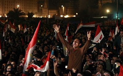 In this Feb. 11, 2011 file photo, Egyptians celebrate the news of the resignation of President Hosni Mubarak, who handed control of the country to the military, at night in Tahrir Square in downtown Cairo, Egypt.(AP Photo/Ben Curtis)