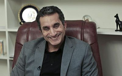 Egyptian satirist Bassem Youssef laughs during an interview with The Associated Press at his studio in downtown Cairo, on January 8, 2014. (AP Photo/Nariman El-Mofty)