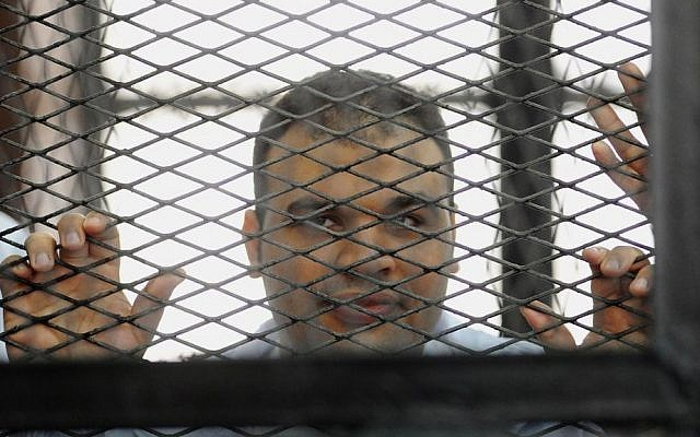 In this Wednesday, Dec. 4, 2013 file photo, Mohammed Badr, a cameraman for Al Jazeera Mubasher Misr, appears at a court in Cairo, Egypt. (AP Photo/Ahmed Omar, File)
