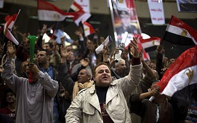 Egyptians chant slogans as they attend a rally in support of Egypt's Defense Minister, Gen. Abdel-Fattah el-Sissi, in Cairo, Egypt, Tuesday, Jan. 21, 2014. (Photo credit: AP Photo/Khalil Hamra)