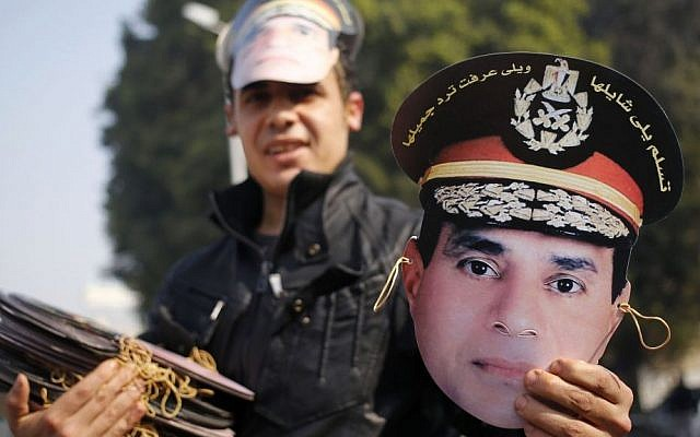 An Egyptian vendor displays a mask of Egypt's Defense Minister, Gen. Abdel-Fattah el-Sissi, in Tahrir Square, in Cairo, Egypt, Saturday, Jan. 25, 2014 (photo credit: AP/Hassan Ammar)
