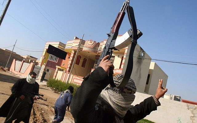 Gunmen patrol in Fallujah, 40 miles (65 kilometers) west of Baghdad, Iraq, on January 9, 2014. (photo credit: AP)