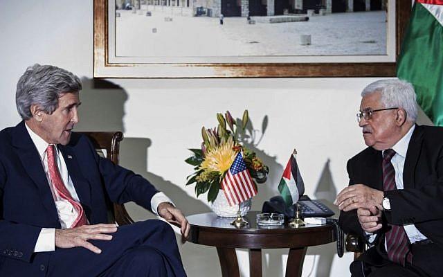 US Secretary of State John Kerry, left, meets with Palestinian Authority President Mahmoud Abbas in Ramallah, on Friday (photo credit: AP/Brendan Smialowski)