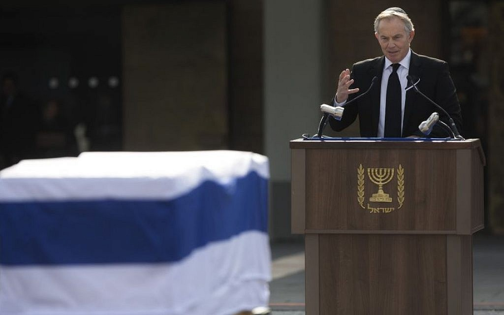 Former British prime minister and Mideast Envoy Tony Blair delivers a speech next to the coffin of Ariel Sharon outside the Knesset in Jerusalem, Monday, January 13, 2014 (photo credit: AP/Sebastian Scheiner)