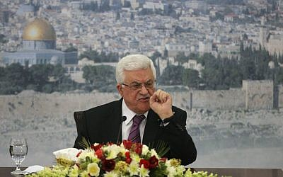Palestinian Authority President Mahmoud Abbas speaks during a meeting at his compound in the West Bank city of Ramallah, Saturday, Jan. 11, 2014. (photo credit: AP/Majdi Mohammed)