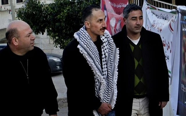 Recently released Palestinian prisoner Jamal Abu Muhsin, center, earned two degrees during his decades of imprisonment in Israel. (photo credit: AP Photo/Nasser Ishtayeh)