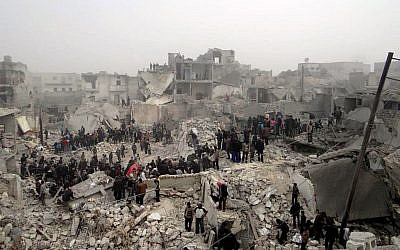 People searching through the debris of destroyed buildings in the aftermath of a strike by Syrian government forces, in the neighborhood of Jabal Bedro, Aleppo, Syria, Feb. 19, 2013. (photo credit: AP/Aleppo Media Center AMC)