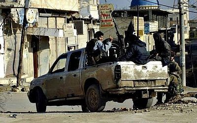 Illustrative photo of Islamic State fighters in Syria, January 14, 2014 (photo credit: AP/militant website)