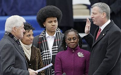 Former president Bill Clinton, left, administers the oath of office to New York City Mayor-elect Bill de Blasio, right, on the steps of City Hall, Wednesday (photo credit: AP/Frank Franklin II)