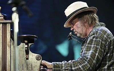 Neil Young performing at Farm Aid, one of his longstanding gigs, in 2010 (Courtesy Wikipedia)