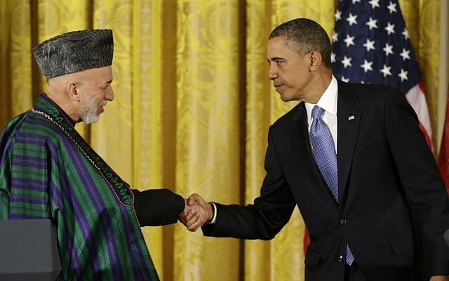 President Barack Obama shakes hands with Afghan President Hamid Karzai at the end of a news conference in the East Room of the White House in Washington in January 2013 (photo credit: AP Photo/Pablo Martinez Monsivais, File)