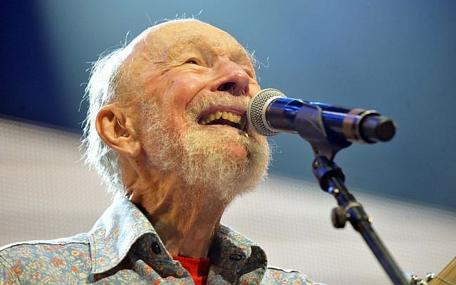 This Sept. 21, 2013, file photo shows Pete Seeger performing on stage during the Farm Aid 2013 concert at Saratoga Performing Arts Center in Saratoga Springs, N.Y. The American troubadour, folk singer and activist Seeger died Monday Jan. 27, 2014, at age 94. (photo credit: AP Photo/Hans Pennink, File)