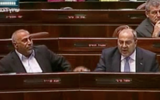 Taleb Abu Arar (left) and Ahmad Tibi heckle Prime Minister Benjamin Netanyahu during a special Knesset session addressed by Canadian Prime Minister Stephen Harper on Tuesday (photo credit: Channel 2 screenshot)
