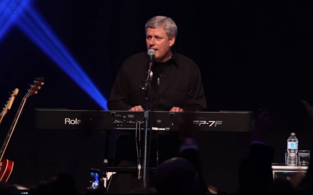 Canadian Prime Minister Stephen Harper performs with his band, Herringbone, at a Jewish National Fund dinner in Toronto, Canada, last month (photo credit: YouTube screenshot)