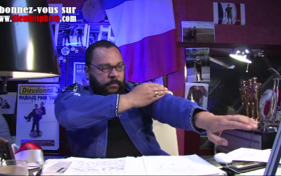 Illustrative photo of anti-Semitic French comedian Dieudonne performing the anti-Semitic quenelle gesture (photo credit: screenshot YouTube)